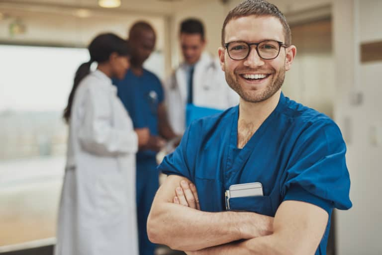Happy optimistic young NHS worker